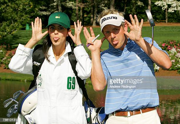 Luke Donald of England clowns around with his fiance Diane Antonopoulos during the Par3 contest prior to the start of The Masters at the Augusta...
