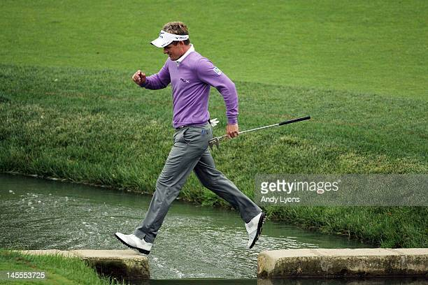 Luke Donald of England crosses a bridge on the way to the green of the par 4 14th hole during the second round of the Memorial Tournament presented...