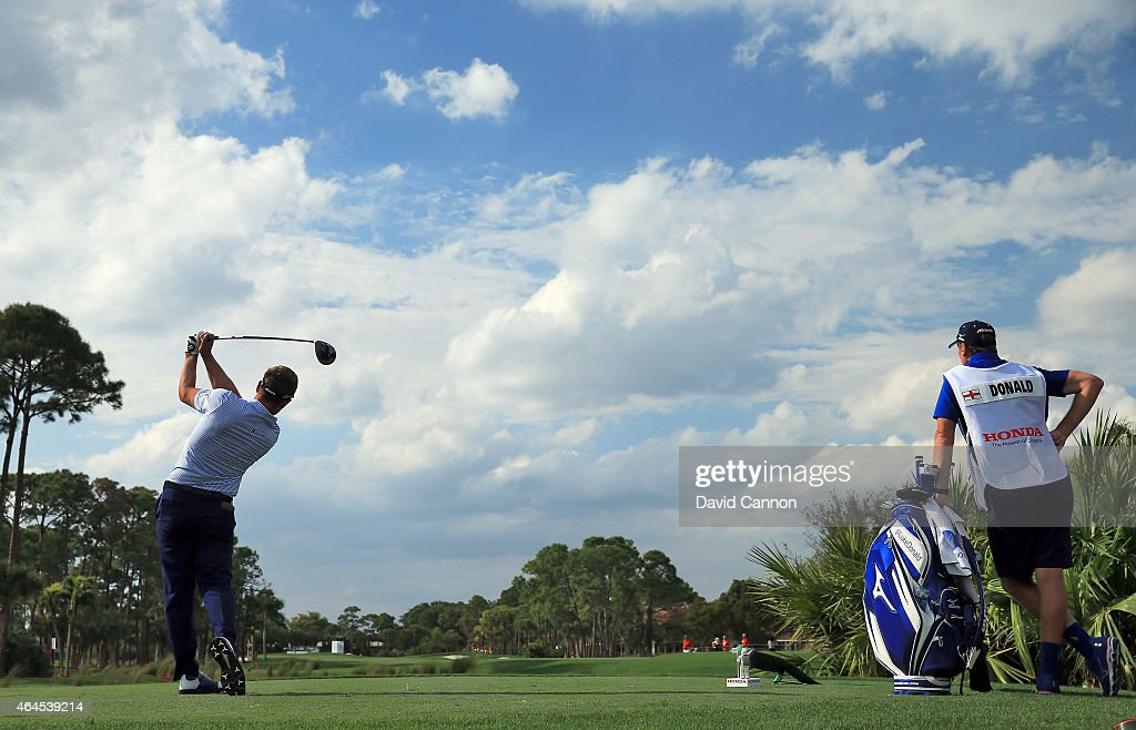 Luke Donald of England drives from the second tee watched by his caddie John McLaren during the first round of The Honda Classic on the Champions Course at the PGA National Resort and Spa on February 26, 2015 in Palm Beach Gardens, Florida.