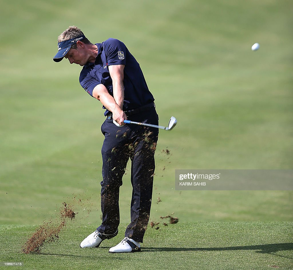 Luke Donald of England follows his shot during the 4rd round of the DP World Tour Championship in the Gulf emirate of Dubai on November 25, 2012. The European Tour's finest have converged on the Greg Norman-designed Earth Course at Jumeirah Golf Estates in Dubai this week aiming to prevent a McIlroy sweep at the season-ending eight million dollar (6.2 million euros) championship.