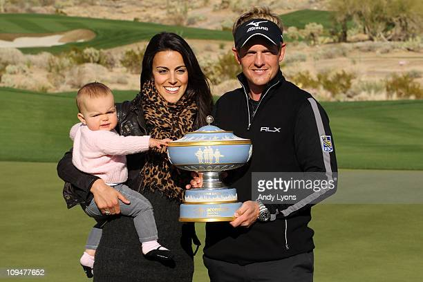 Luke Donald of England his wife Diane and daughter Elle celebrate with The Walter Hagen Cup trophy after winning his match 3up on the 16th hole...