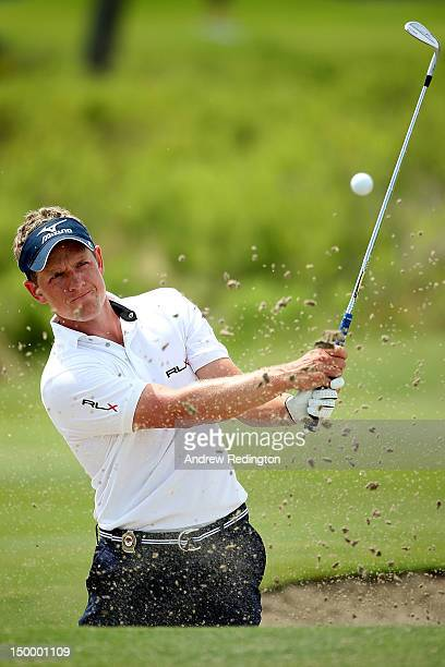 Luke Donald of England hits a bunker shot during a practice round of the 94th PGA Championship at the Ocean Course on August 8 2012 in Kiawah Island...