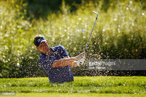 Luke Donald of England hits a bunker shot on the fourth hole during the first round of The Barclays at the Ridgewood Country Club on August 26 2010...