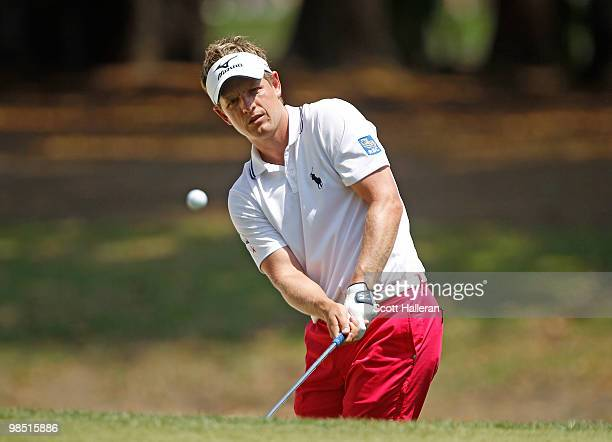 Luke Donald of England hits a pitch shot on the seventh hole during the third round of the Verizon Heritage at the Harbour Town Golf Links on April...
