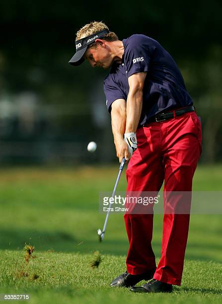 Luke Donald of England hits a shot from the rough on the 14th hole during the first round of the 2005 PGA Championship at Baltusrol Golf Club on...