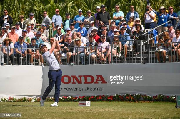 Luke Donald of England hits a shot on the first tee during the final round of The Honda Classic at PGA National Champion course on March 1 2020 in...