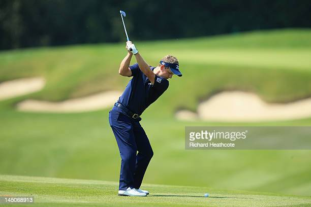 Luke Donald of England hits an approach shot during the ProAm round prior to the BMW PGA Championship on the West Course at the Wentworth Club on May...