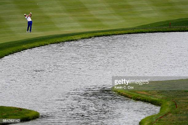 Luke Donald of England hits an approach shot on the 18th hole during the first round of the 2016 PGA Championship at Baltusrol Golf Club on July 28...