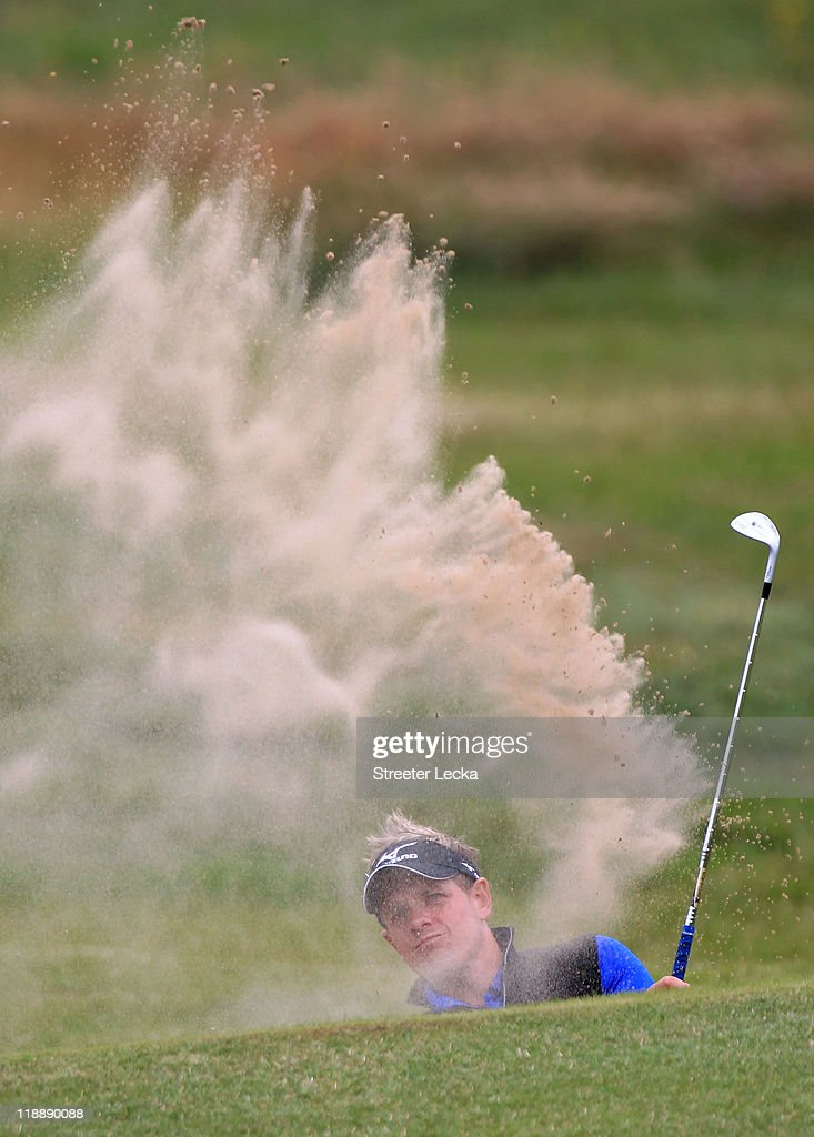 Luke Donald of England hits from a bunker during the second practice round during The Open Championship at Royal St. George's on July 12, 2011 in Sandwich, England. The 140th Open begins on July 14, 2011.