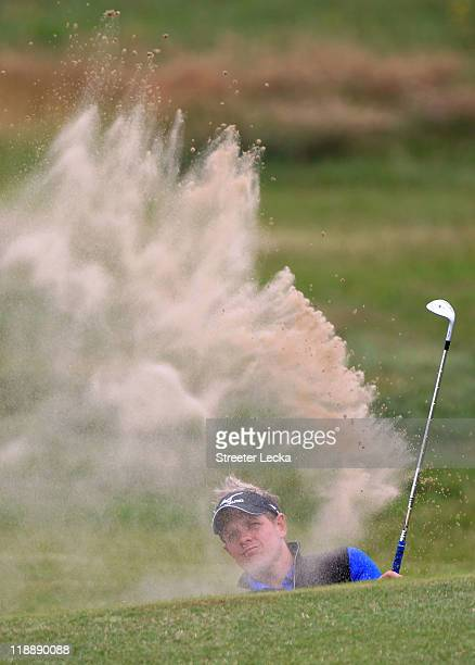 Luke Donald of England hits from a bunker during the second practice round during The Open Championship at Royal St. George's on July 12, 2011 in...
