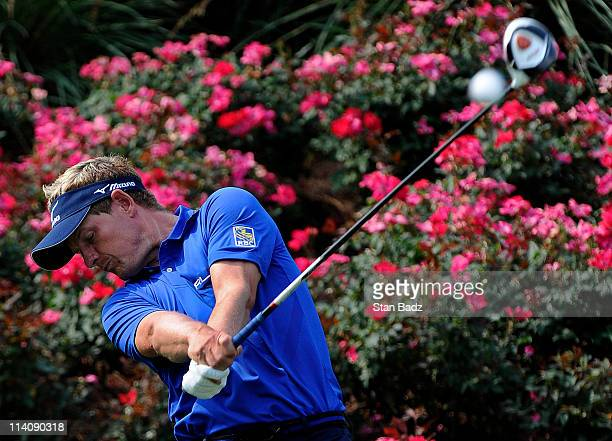 Luke Donald of England hits from the 18th tee box during practice for THE PLAYERS Championship on THE PLAYERS Stadium Course at TPC Sawgrass on May...
