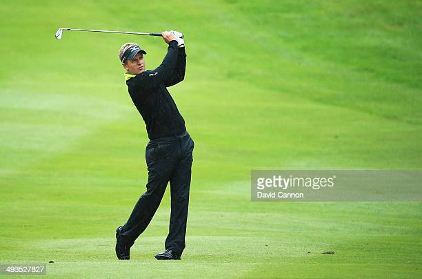 Luke Donald of England hits his 2nd shot on the 4th hole during day three of the BMW PGA Championship at Wentworth on May 24 2014 in Virginia Water...