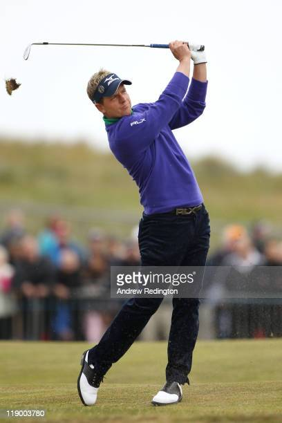 Luke Donald of England hits his approach shot on the 1st hole during the first round of The 140th Open Championship at Royal St George's on July 14...