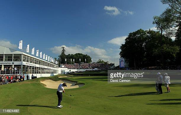 Luke Donald of England hits his approach shot to the 18th green in a playoff during the final round of the BMW PGA Championship at the Wentworth Club...