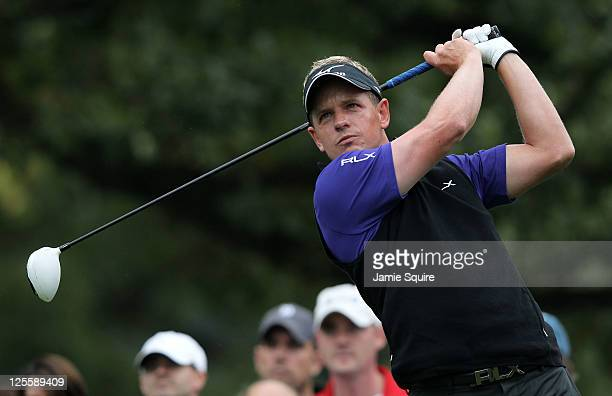 Luke Donald of England hits his first shot on the third hole during the final round of the BMW Championship at Cog Hill Golf Country Club on...