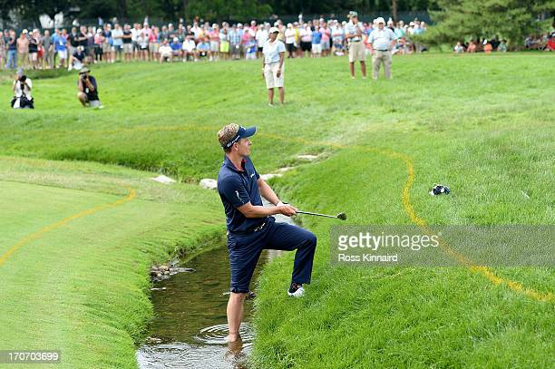 Luke Donald of England hits his fourth shot on the fourth hole during the final round of the 113th U.S. Open at Merion Golf Club on June 16, 2013 in...