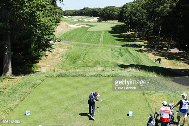 Luke Donald of England hits his tee shot on the fourth hole during the third round of The Barclays in the PGA Tour FedExCup PlayOffs on the Black...