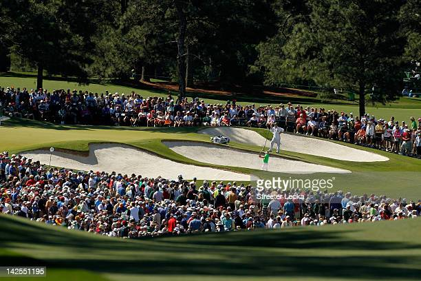 Luke Donald of England hits out of the bunker on the seventh hole during the third round of the 2012 Masters Tournament at Augusta National Golf Club...