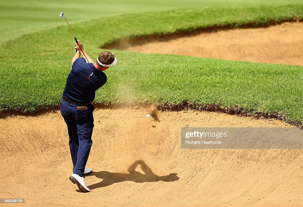 Luke Donald of England hits the lip of a fairway bunker on the 10th, leaving his ball in the sand during the final round of the Nedbank Golf Challenge at the Gary Player Country Club on December 7, 2014 in Sun City, South Africa.