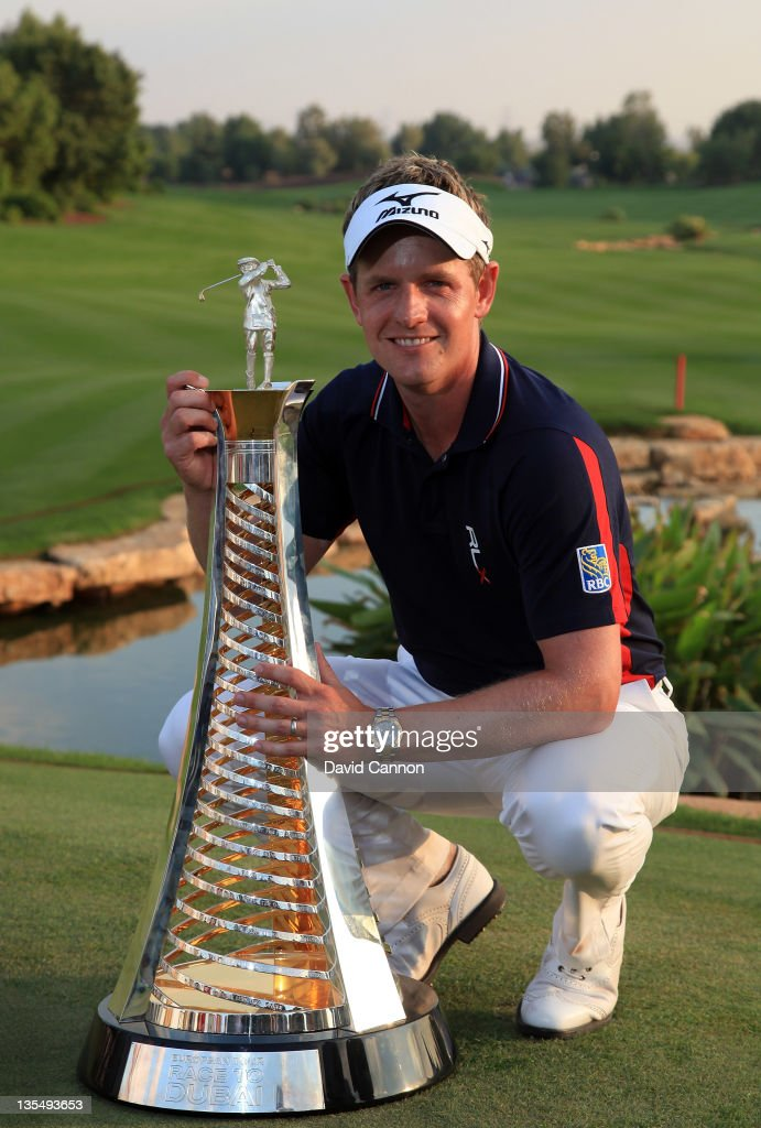 Luke Donald of England holds the Race to Dubai Trophy after finishing in third place that secured his title during the final round of the Dubai World Championship on the Earth Course at the Jumeirah Golf Estates on December 11, 2011 in Dubai, United Arab Emirates.
