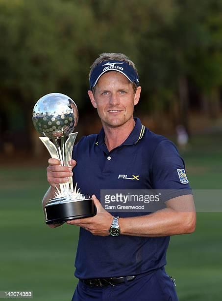 Luke Donald of England holds the trophy after winning the Transitions Championship at the Innisbrook Resort and Golf Club on March 18 2012 in Palm...