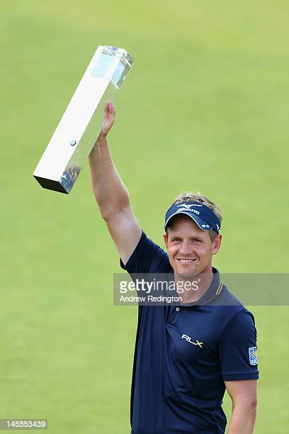 Luke Donald of England holds the trophy aloft following his victory during the final round of the BMW PGA Championship on the West Course at...