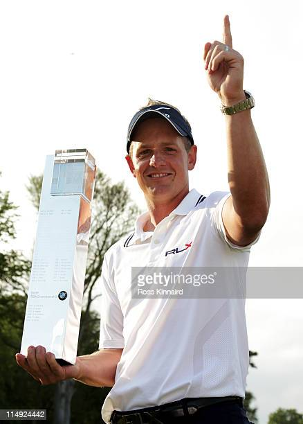 Luke Donald of England holds the trophy following his victory in a playoff on the 18th green, which also secured him the Number one World ranking...