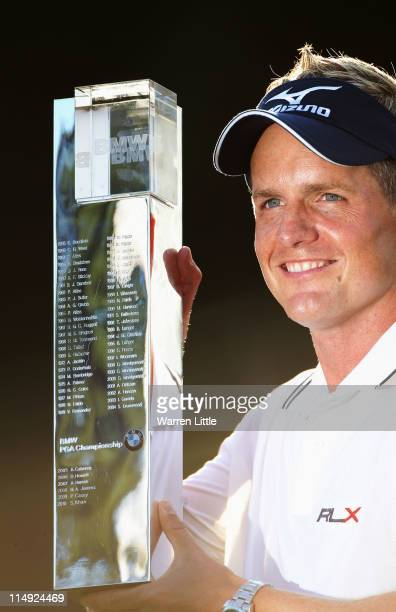 Luke Donald of England holds the trophy following his victory in a playoff during the final round of the BMW PGA Championship at the Wentworth Club...