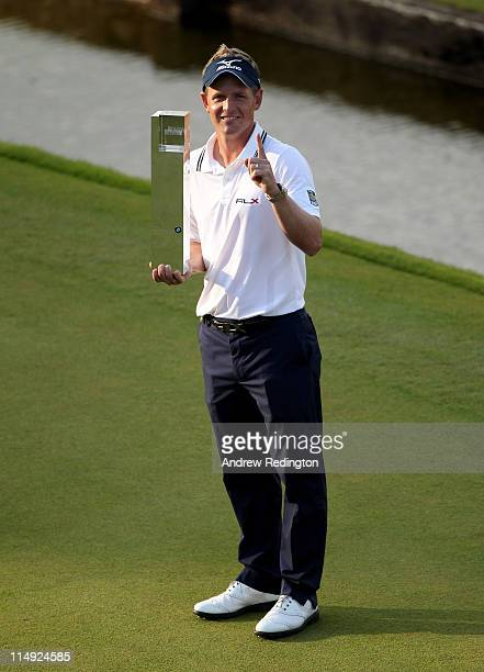 Luke Donald of England holds the trophy following his victory in a playoff which also secured him the Number One World Ranking during the final round...