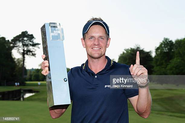 Luke Donald of England holds the trophy following his victory which also regained him the Number one World ranking during the final round of the BMW...