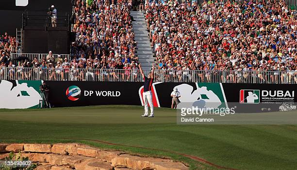 Luke Donald of England holes a birdie putt at the par 5, 18th hole to finish in third place that secured his Race to Dubai title during the final...