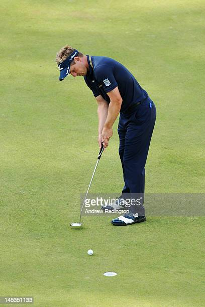 Luke Donald of England holes his putt on the 18th green to win during the final round of the BMW PGA Championship on the West Course at Wentworth on...