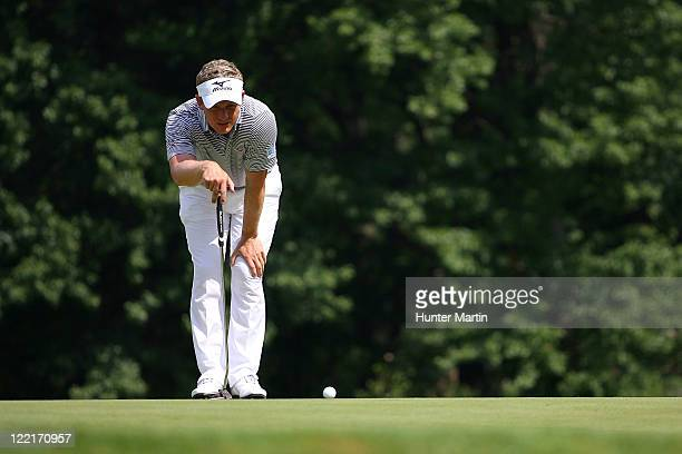 Luke Donald of England lines up a birdie putt on the 18th hole green during round two of The Barclays at Plainfield Country Club on August 26 2011 in...