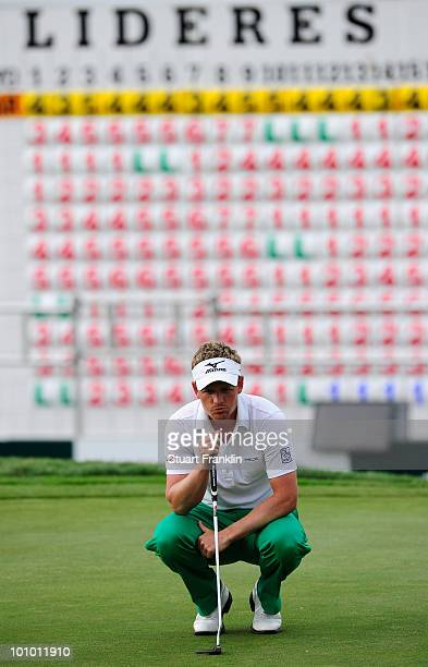 Luke Donald of England lines up his putt on the 18th hole during the first round of the Madrid Masters at Real Sociedad Hipica Espanola Club De Campo...