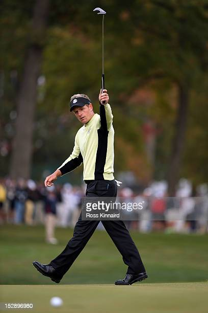 Luke Donald of England of Europe watches a putt on the fifth green during the Morning Foursome Matches for The 39th Ryder Cup at Medinah Country Club...