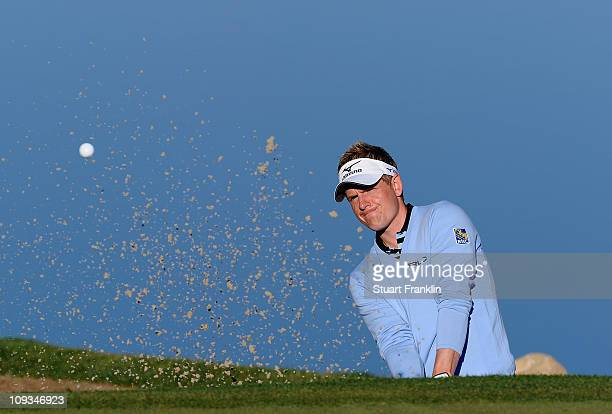 Luke Donald of England plays a bunker shot during practice prior to the start of the World Golf ChampionshipsAccenture Match Play Championship held...