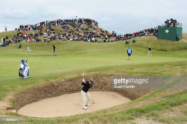 Luke Donald of England plays a bunker shot during the final practice round during The Open Championship at Royal St. George's on July 13, 2011 in...