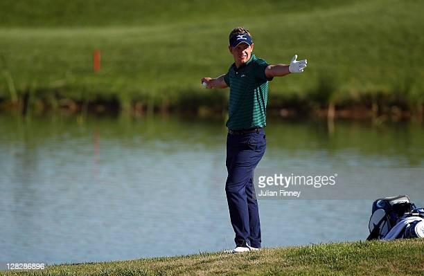 Luke Donald of England plays a drop shot after finding the water on the 18th during round one of the Madrid Masters Golf at El Encin Golf Hotel on...