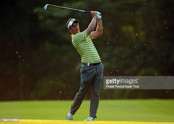 Luke Donald of England plays a shot during previews ahead of the Maybank Malaysian Open at Kuala Lumpur Golf & Country Club on March 20, 2013 in...