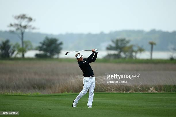 Luke Donald of England plays a shot on the 18th fairway during the third round of the RBC Heritage at Harbour Town Golf Links on April 19 2014 in...