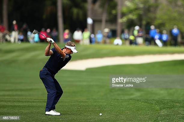 Luke Donald of England plays a shot on the 5th fairway during the final round of the RBC Heritage at Harbour Town Golf Links on April 20 2014 in...