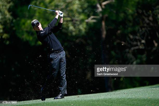 Luke Donald of England plays a shot on the 7th hole during the first round of the Valspar Championship at Innisbrook Resort and Golf Club on March 13...