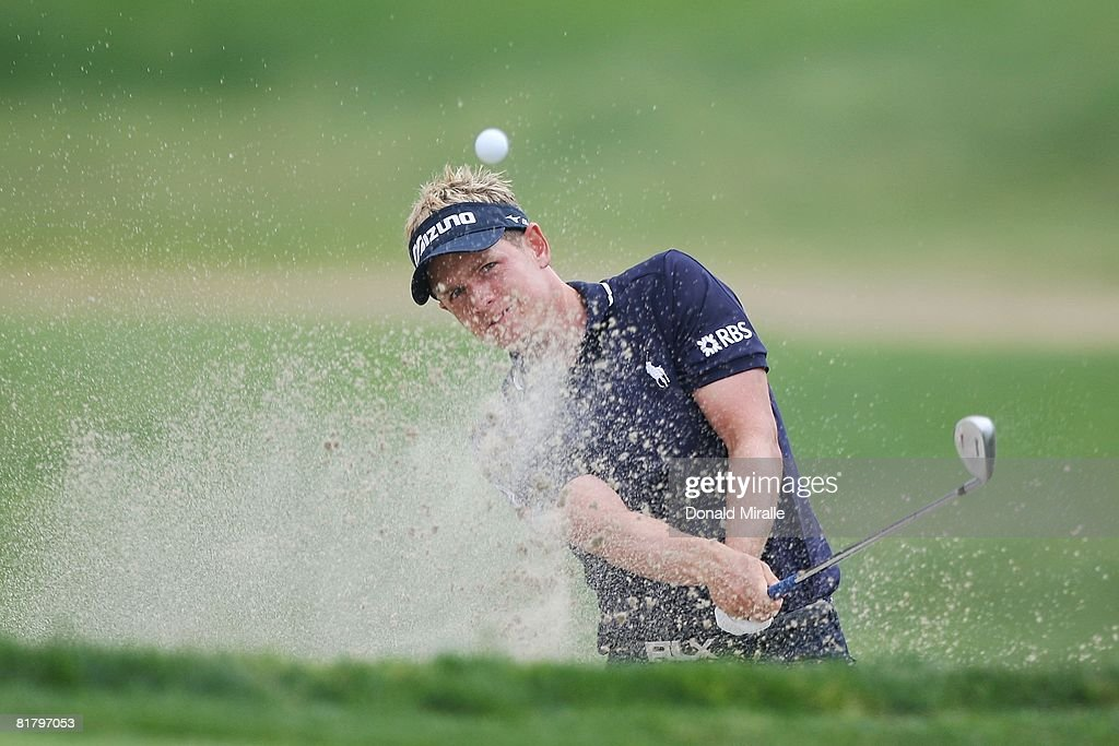 Luke Donald of England plays from a greenside bunker on the eighth hole during the third round of the 108th U.S. Open at the Torrey Pines Golf Course (South Course) on June 14, 2008 in San Diego, California.