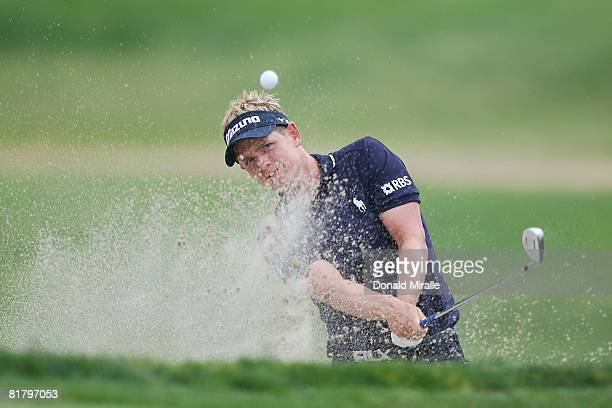 Luke Donald of England plays from a greenside bunker on the eighth hole during the third round of the 108th US Open at the Torrey Pines Golf Course...