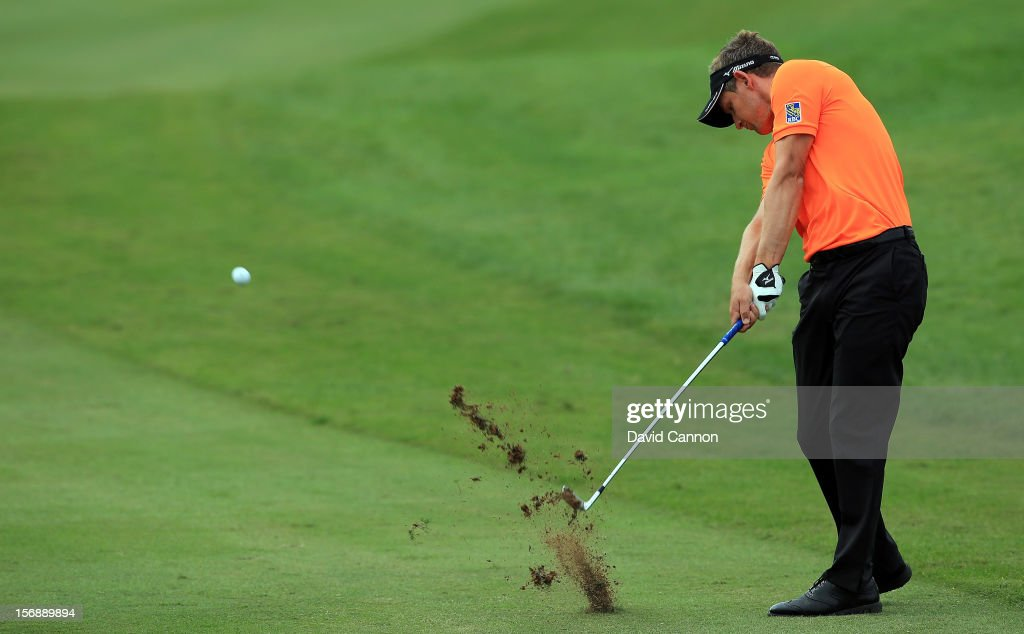Luke Donald of England plays his second shot at the par 4, 5th hole during the third round of the 2012 DP World Tour Championship on the Earth Course at Jumeirah Golf Estates on November 24, 2012 in Dubai, United Arab Emirates.