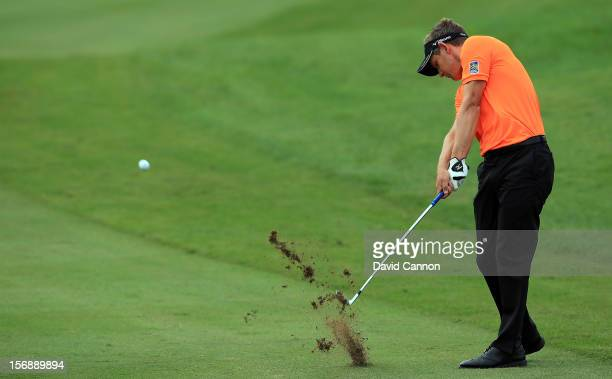 Luke Donald of England plays his second shot at the par 4, 5th hole during the third round of the 2012 DP World Tour Championship on the Earth Course...