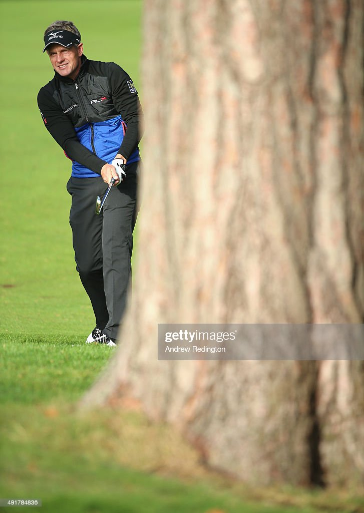 Luke Donald of England plays his second shot on the 13th hole during the first round of the British Masters supported by Sky Sports at Woburn Golf Club on October 8, 2015 in Woburn, England.