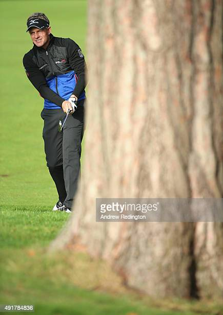 Luke Donald of England plays his second shot on the 13th hole during the first round of the British Masters supported by Sky Sports at Woburn Golf...