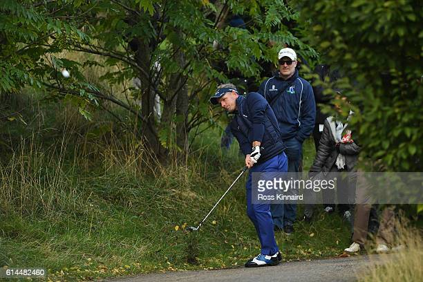 Luke Donald of England plays his second shot on the 15th hole during the second round of the British Masters at The Grove on October 14 2016 in...