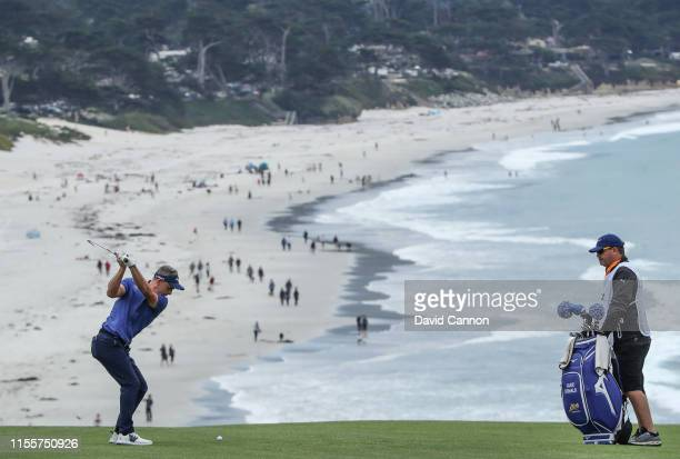 Luke Donald of England plays his second shot on the par 4 ninth hole during the first round of the 2019 USOpen at the Pebble Beach Golf Links on June...